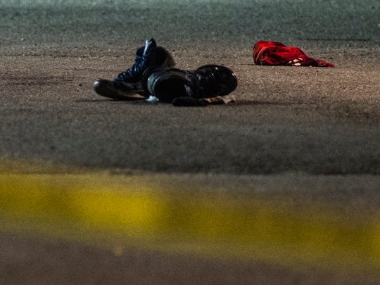 A pair of shoes lies at the center of an area surrounded by police tape at the Champlain Valley Exposition early Monday morning after a fatal stabbing late Sunday night.