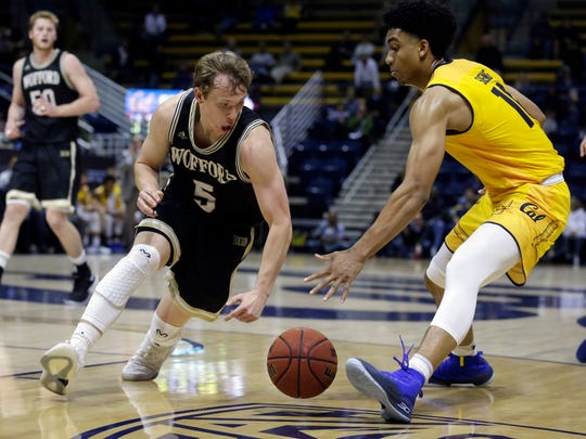 Wofford's Storm Murphy, left, and California's Justice Sueing, right, chase a loose ball during the second half of an NCAA college basketball game Thursday, Nov. 16, 2017, in Berkeley, Calif. (AP Photo/Ben Margot)