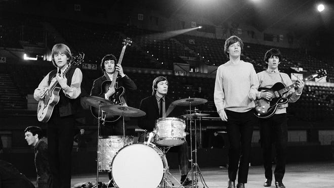 The Rolling Stones (from left, Brian Jones, Bill Wyman, Charlie Watts, Mick Jagger and Keith Richards) are seen during a 1964 rehearsal.
