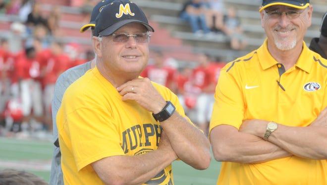 Murphy football coach David Gentry, left, has won a Western North Carolina-record 346 games.