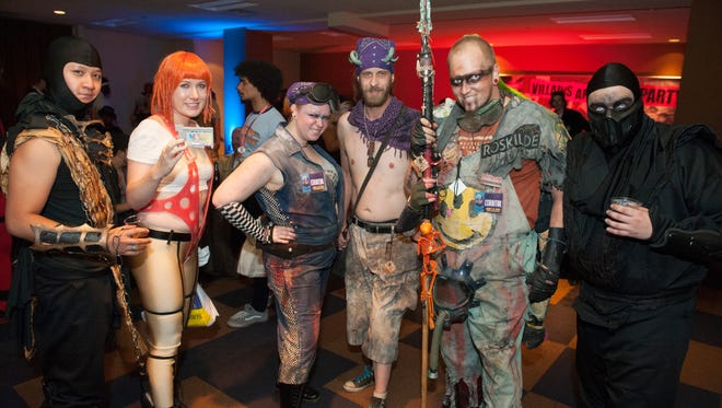 Some characters strike a pose at Phoenix ComiCon 2014 on Saturday, June 7, in Downtown Phoenix.