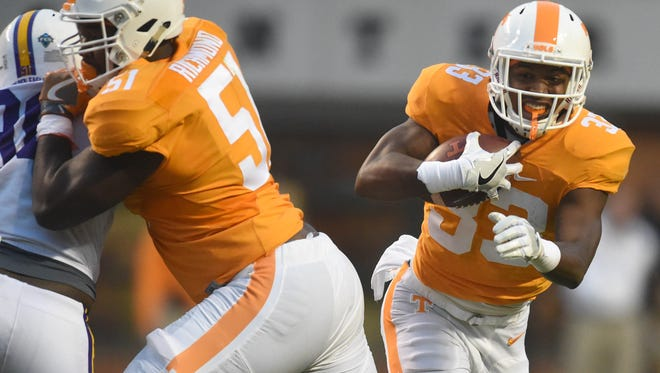 Tennessee running back Jeremy Lewis (33) carries the ball against Tennessee Tech during the second half at Neyland Stadium on Saturday, Nov. 5, 2016.