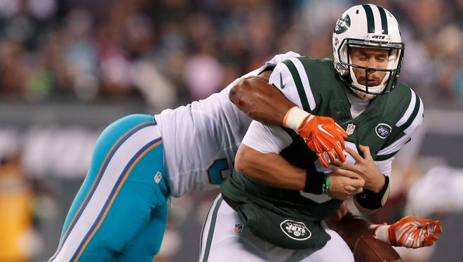 Jets quarterback Bryce Petty fumbling the ball as he is sacked by Dolphins defensive end Cameron Wake during Saturday night's game at MetLife Stadium. (AP Photo/Adam Hunger)