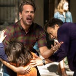 "Dylan Schombing, Thomas Sadoski (background left) and Peter Sarsgaard (right) appear in a scene from ""The Slap,"" an eight-hour miniseries premiering Feb. 12."
