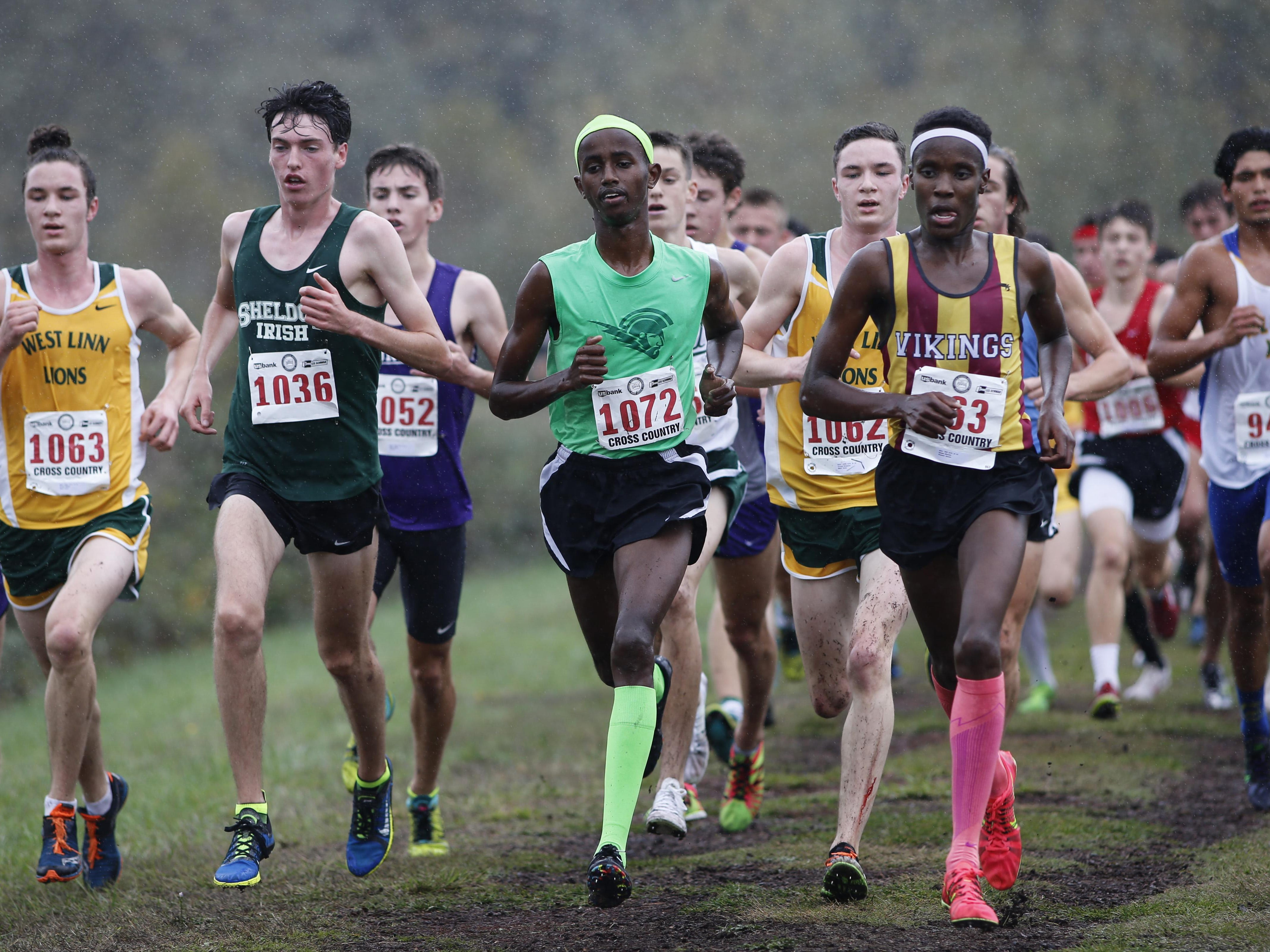West Salem's Ahmed Muhumed, center, runs in the lead pack in the 6A state cross country championships at Lane Community College on Saturday, Oct. 31, 2015. Muhumed won the state championship. (Timothy J. Gonzalez/For the Statesman Journal)