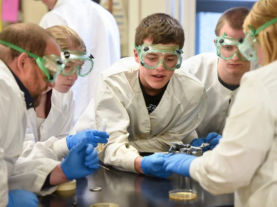 Students gather to complete a lab activity during a Project Lead The Way class Thursday, April 27, at Paynesville High School.