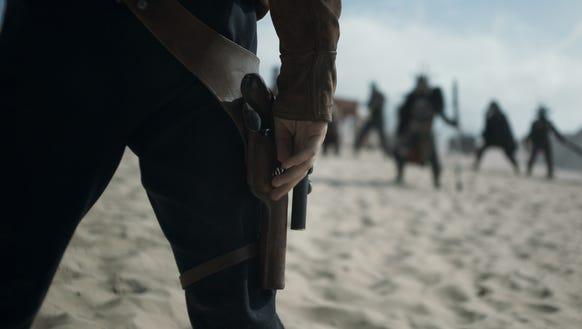 Alden Ehrenreich is ready for a gunfight as Han Solo.