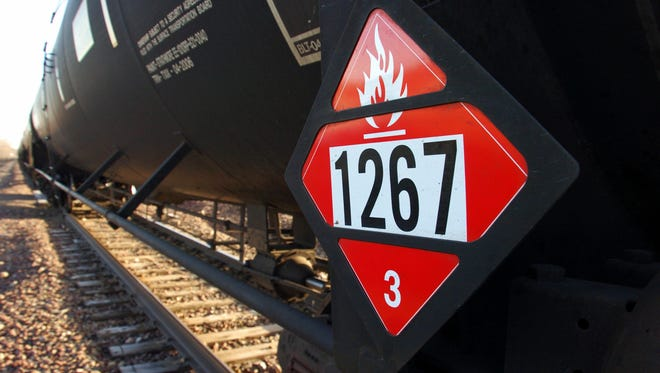This Nov. 6, 2013, file photo shows a warning placard on a tank car carrying crude oil near a loading terminal in Trenton, North Dakota.