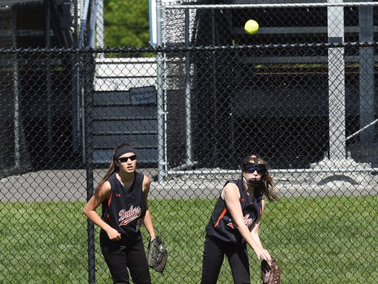 Marlboro's Kasey Conn, right, throws the ball in from