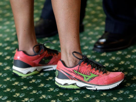 Sen. Wendy Davis, D-Fort Worth, wears running shoes as she filibusters in an effort to kill an abortion bill June 25, 2013, in Austin, Texas.