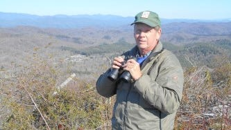 Retired teacher Ed Moorer leads a group that monitors migrating raptors from atop Sassafras Mountain in Pickens County.