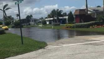 Flooding at the entrance to Lamplighter Village after Hurricane Irma