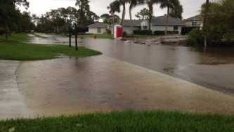 One residential road in Sebastian remained flooded Oct. 2, 2017, after a recent storm. Residents along streets prone to flooding could see some relief now that the City Council has unanimously approved a plan to fix clogged or broken pipes under private driveways.