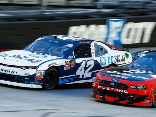 Kyle Larson (42) leads Joey Logano (22) on a restart during a NASCAR Xfinity Series auto race on Friday, Aug. 17, 2018, in Bristol, Tenn. (AP Photo/Wade Payne)
