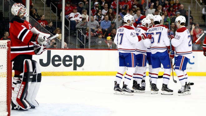 The Canadiens celebrate a goal by Alex Galchenyuk (27) as Devils goalie Keith Kinkaid, left, waits during the game Friday, Jan. 20, 2017, in Newark. The Canadiens won, 3-1 as the Devils took a season-low 17 shots on goal.