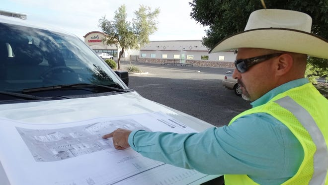 Las Cruces Construction Projects Administrator David Sedillo shows designs for a street upgrade on Utah Avenue. This design involves coordinating with Las Cruces Utilities to be sure all underground utilities running beneath the street are upgraded as part of the project.