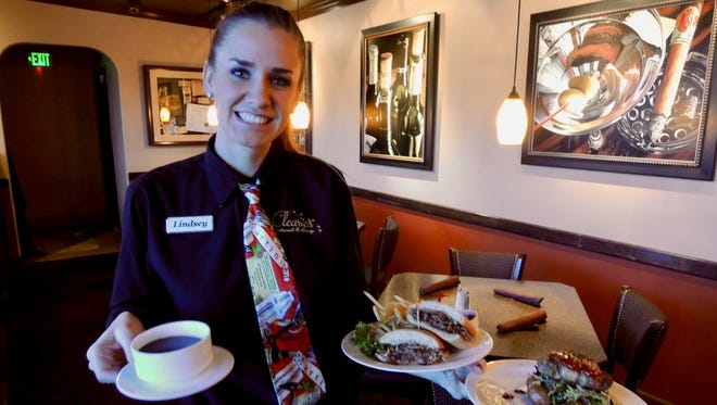 Lindsey Willson with lunch order at Clearie's Restaurant in downtown Redding.