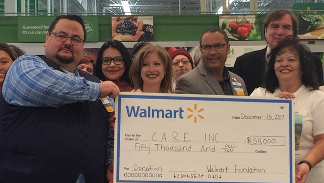 CARE Executive Director Yolanda Diaz, right, holds a $50,000 check from the Walmart Foundation. The check was awarded during a presentation Friday, Dec. 15, 2018, at the Walmart on Rinconada Boulevard.