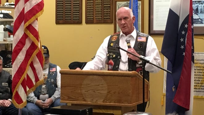 Scott Magill, executive director of Veterans in Defense of Liberty, speaks to a crowd at Springfield's American Legion Post 639 on Saturday. The group assembled as part of an effort to bring awareness to those classified as prisoners or war and missing in action since World War II.