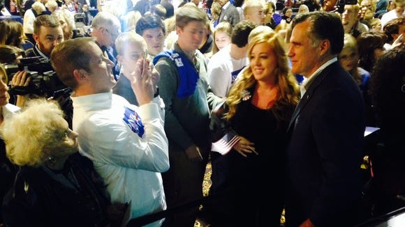 Mitt Romney mingles with supporters during an event for Mike Rounds on Thursday in Sioux Falls.