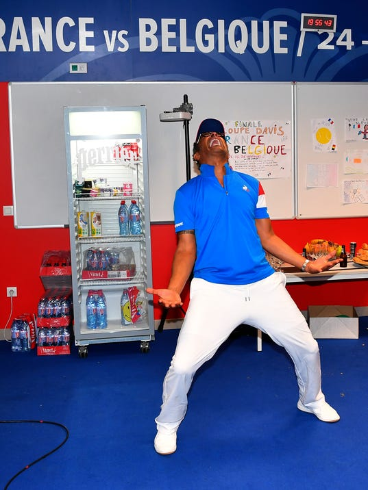 French captain Yannick Noah celebrateS the French team victory in the cloakroom after France won the Davis Cup at the Pierre Mauroy stadium in Lille, northern France, Sunday, Nov.26, 2017. France won the Davis Cup for the first time in 16 years after beating Belgium 3-2. (Antoine Couvercelle, Pool via AP)