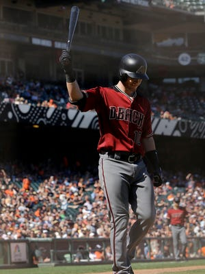 Arizona Diamondbacks' Chris Herrmann walks to the dugout after striking out against the San Francisco Giants during the ninth inning of a baseball game in San Francisco, Sunday, Aug. 6, 2017. The Giants won 6-3.