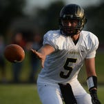 Winchester's Austin Lawrence pitches the ball off against Northeastern during a football game Friday in Fountain City.