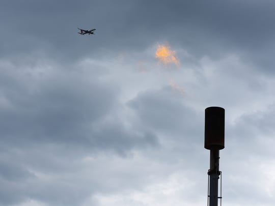 The flame that burns off methane at the Kingsland Landfill