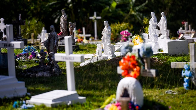 Concrete crosses and statues serve as markers for many of the graves at the Vicente A. Limtiaco Memorial Cemetery in Piti on Thursday, Jan. 4, 2018.