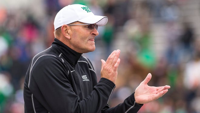The Iowa football team is paying North Texas $900,000 to compete in a 2015 football game at Kinnick Stadium, according to the game contract. This coming season, Texas is paying the Mean Green, coached by former Iowa State leader Dan McCarney, $875,000.