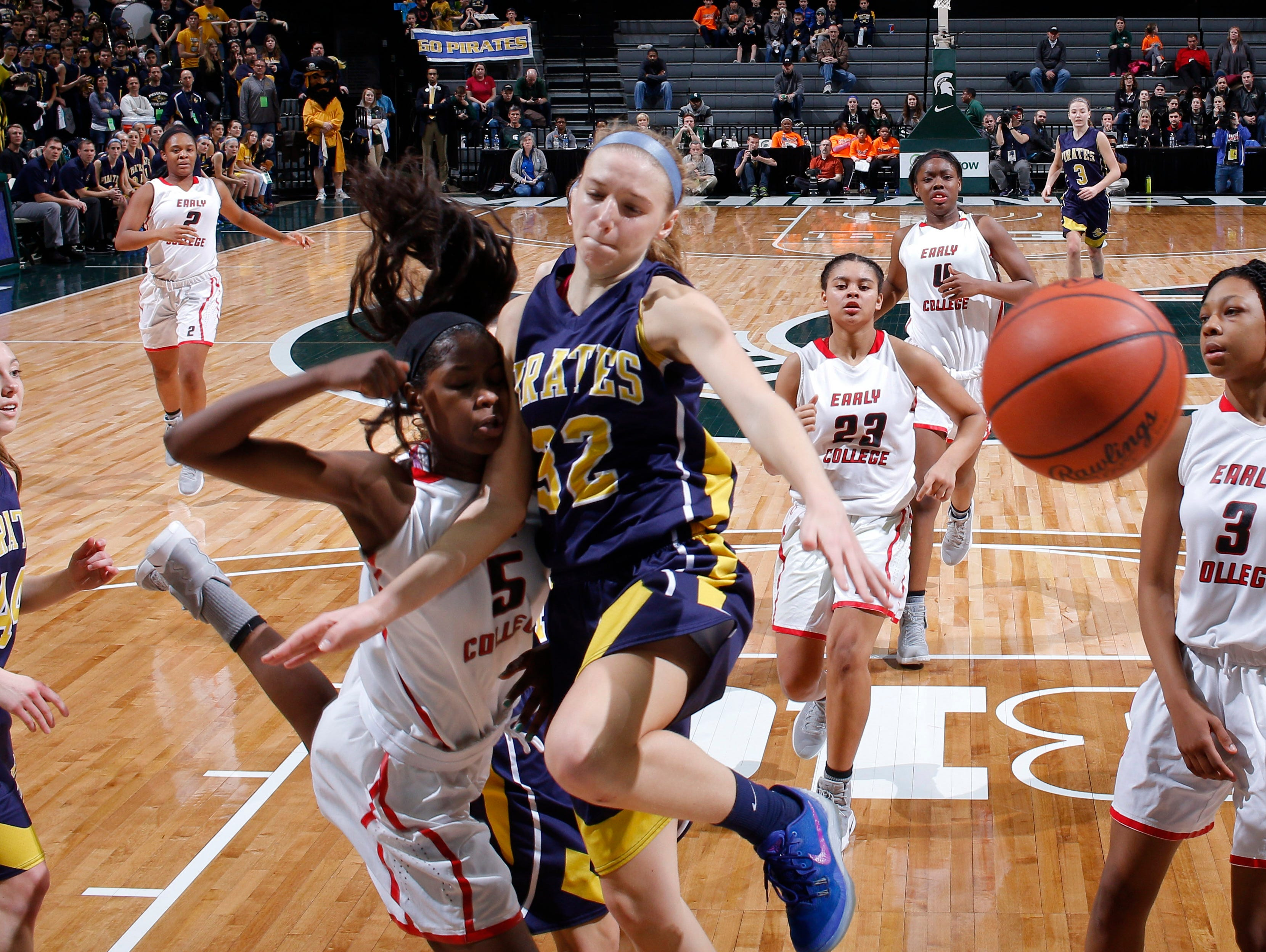 Pewamo-Westphalia's Emily Spitzley (32) and Detroit Edison's Rickea Jackson collide under the basket as P-W's Brenna Wirth, left, and Detroit Edison's Shaulana Wagner (23) and Gabrielle Elliott (3) watch during their MHSAA Class C championship game, Saturday, March 18, 2017, in East Lansing, Mich. P-W fell 46-44.