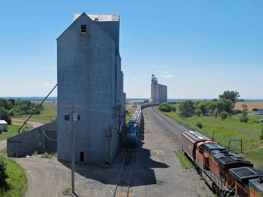 A mile-long grain train is loaded with more than 20