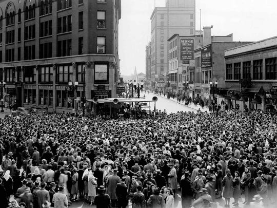 Crowds gather downtown Rochester after the surrender