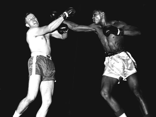 The flashing right hand of Cassius Clay is typical of the action most of the way in his professional debut with Tunney Hunsaker. Clay won a unanimous six-round decision last night at Freedom Hall. 