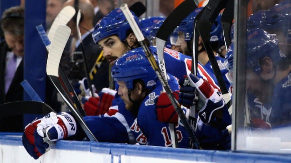 Brian Boyle and Derek Dorsett look on glumly from the Rangers' bench during the third period Monday night.