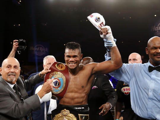 Eleider Alvarez, center, of Colombia, celebrates after he knocked out Sergey Kovalev, of Russia, in the seventh round of their boxing bout at 175 pounds, Saturday, Aug. 4, 2018, in Atlantic City, N.J. (AP Photo/Mel Evans)