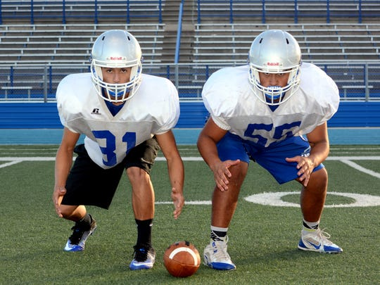 Senior defensive tackle Genarro Flores and senior cornerback Jesus Ornelas (81) are among the key returners for Carlsbad's defense in 2016.