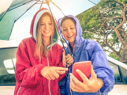 Women best friends enjoying with smartphone with sun coming out