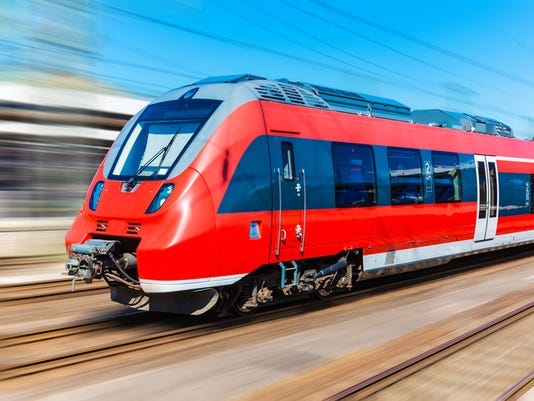 Red high-speed train with blurred motion