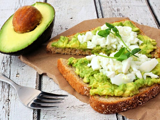 Avocado toast with egg whites and pea shoots