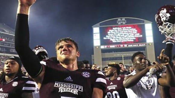Mississippi State quarterback Nick Fitzgerald (7) celebrate his team's 27-14 win over South Carolina in an NCAA college football game in Starkville, Miss., Saturday, Sept. 10, 2016.