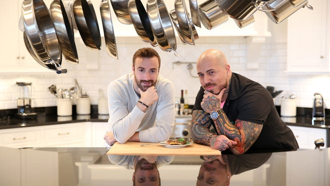 IndyCar driver James Hinchcliffe and Rev celebrity chef Vic Moea, aka Vic Vegas, pondere matters of taste at the Rev kick-off breakfast Dec. 1 at the home of Deborah and Randall Tobias.s