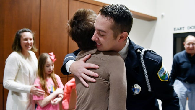 Police Officer Michael Kimes greets Melissa Smith shortly after an awards ceremony Wednesday at the Susquehanna Regional Police Department in East Donegal Township, Lancaster County. The former Hellam Township woman, 26, shot herself in the head in October. Kimes, responding to a neighbor's phone call, found Smith and responded with first aid, and remained at the scene until an ambulance arrived. He visited Smith in the hospital three times, on his own time, afterward, and again after she was released. Kimes was recognized for meritorious conduct at a department awards ceremony.