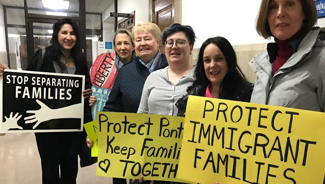 Terry Beltran (on left), of Ask the Latina, with other Latino or immigrant advocates, at Pontiac City Hall for City Council meeting on March 23, 2017, to support a statement for immigrants.