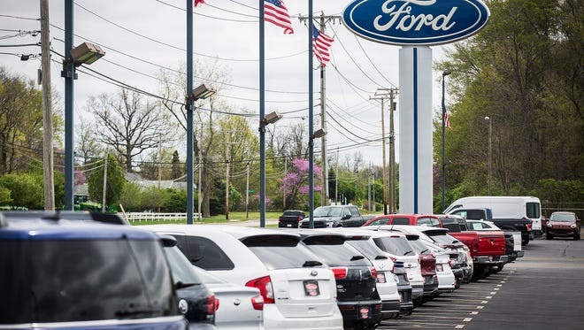 The Dellen Ford dealership pole sign on E. McGalliard Road Friday morning.