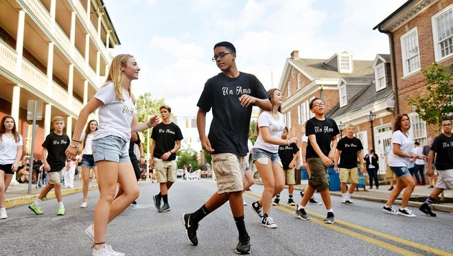 Emma Sager and Michael Jordan, both 14, perform a choreographed salsa dance with fellow students on North Beaver Street during a recent First Friday in downtown York.