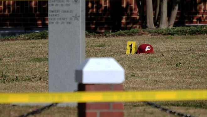 Evidence is marked outside of the Nash County Courthouse in Nashville, N.C., after a shooting.