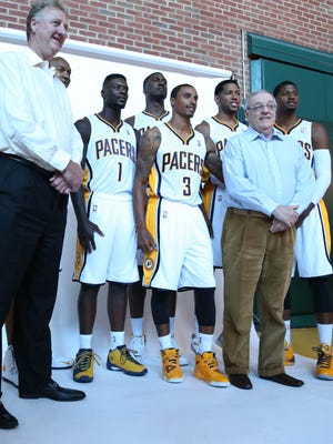 Pacers President Larry Bird, left, takes a photo with his six top players and vice president Donnie Walsh for media day before the season.