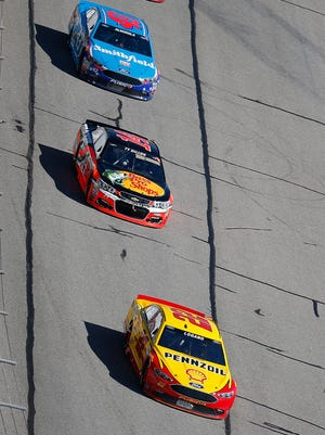 "Joey Logano, front, said a driver with a fast car at Atlanta Sunday could  ""definitely could pass the car in front of him, no doubt."""