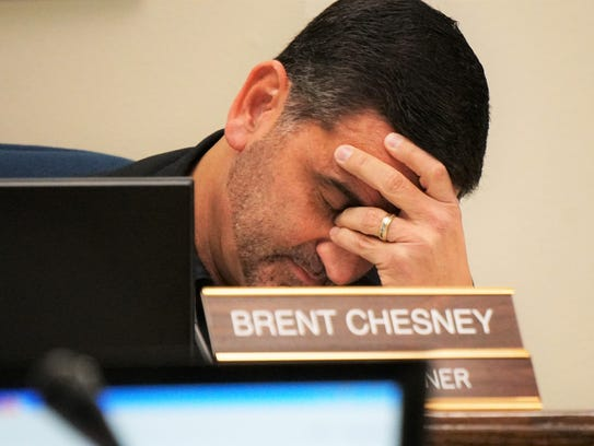 Nueces County Commissioner Brent Chesney reacts to